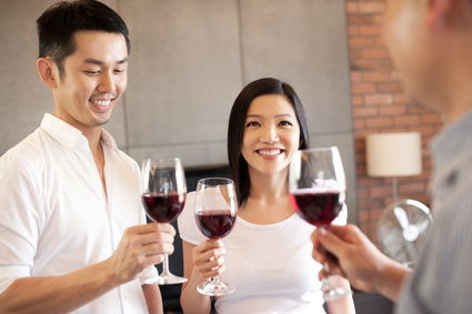 Asian family having wine