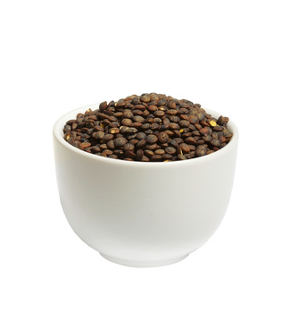 Bowl of dry  french green puy lentils, isolated