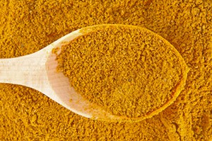 Curry spice with wooden spoon