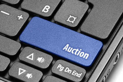 Auction. Blue hot key on computer keyboard