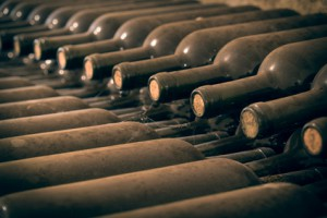 Old wine bottles stacked for aging